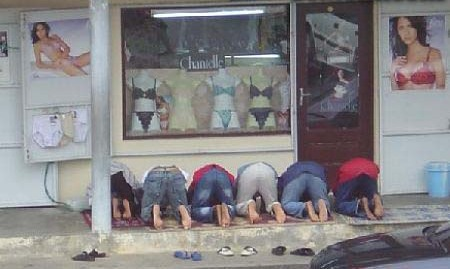 Praying in front of chantelle lingerie.jpg
